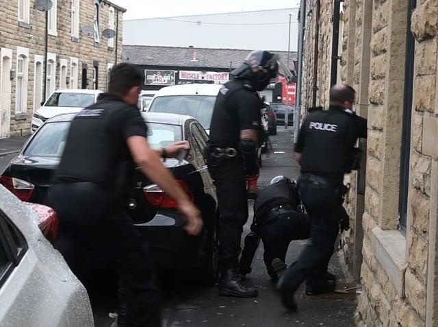 Officers battering the door down