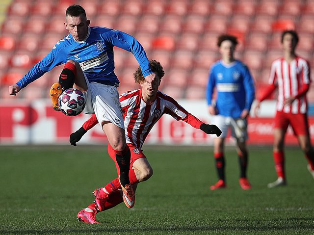 Ciaran Dickson of Rangers vies with Mario Soriano of Athletico Madrid during the UEFA Youth League match between Rangers U19 and Atletico Madrid U19 at Firhill Park on February 12, 2020 in Glasgow, United Kingdom.
