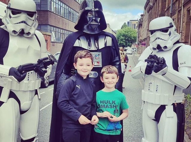 Two young visitors at the Healthier Heroes' Armed Forces Day meet the Star Wars characters