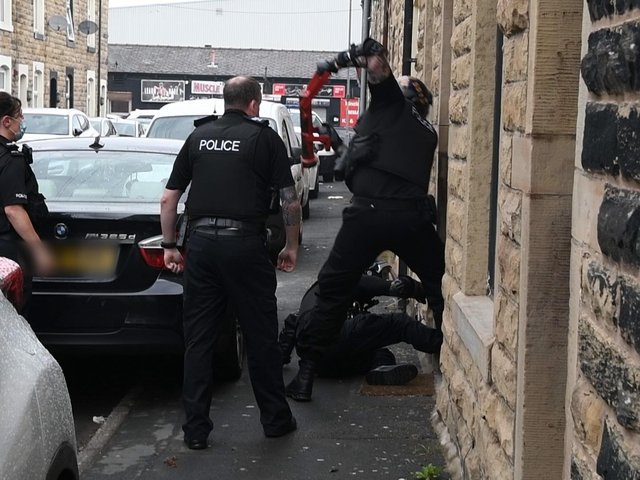 Police executed warrants at addresses in Burnley, Nelson and Blackburn.