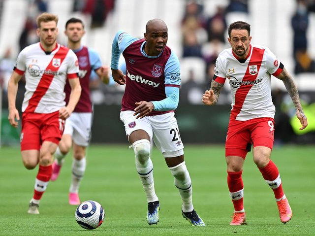Angelo Ogbonna of West Ham United battles for possession with Danny Ings of Southampton during the Premier League match between West Ham United and Southampton at London Stadium on May 23, 2021 in London, England.