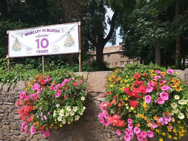 Wall-mounted floral planter as the village prepares to enter this year's contest