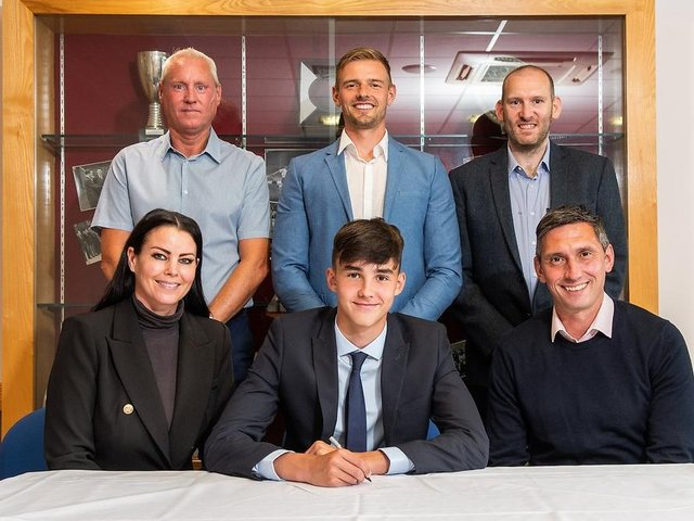 Charlie Casper with family and and Under 18 coaches Tony Philliskirk and John Townson. PICTURE: Burnley Football Club