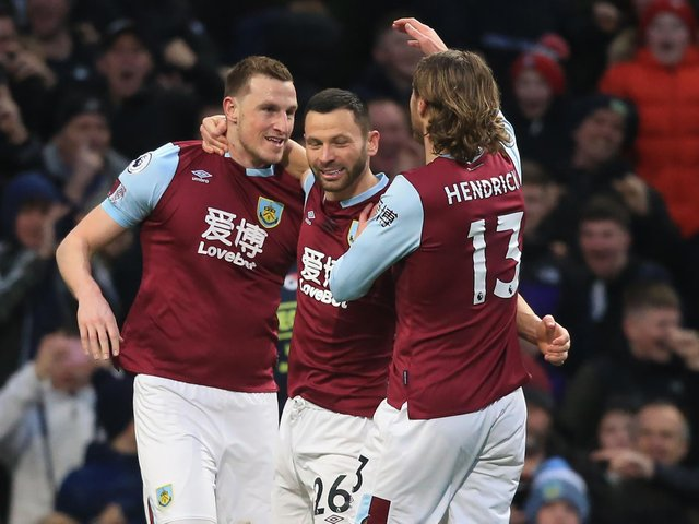 Chris Wood celebrates his opener against Spurs in March 2020