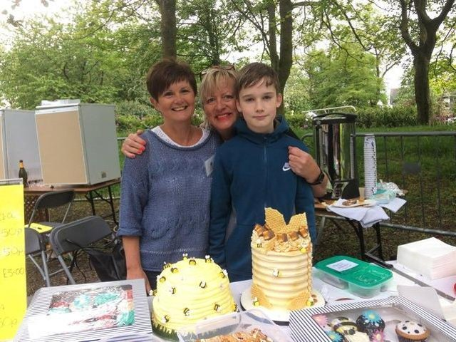 Cake stall holders Lindsey Dyer (left) and Mary Potter serve customer Robbie Dixon at the Buzzin' Bee Day held in Ightenhill Park in May, 2019