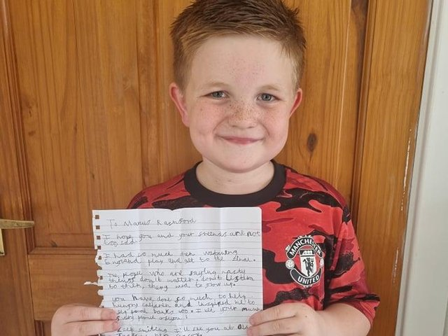 Alfie with the letter he has written to Marcus Rashford and his team mates