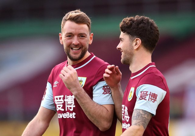 BURNLEY, ENGLAND - JANUARY 09: Dale Stephens and Robbie Brady of Burnley share a joke during the FA Cup Third Round match between Burnley and Milton Keynes Dons at Turf Moor on January 09, 2021 in Burnley, England. The match will be played without fans, behind closed doors as a Covid-19 precaution. (Photo by Alex Pantling/Getty Images)