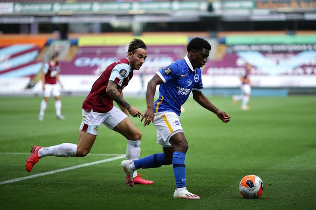 BURNLEY, ENGLAND - JULY 26: Tariq Lamptey of Brighton and Hove Albion and Josh Brownhill of Burnley battle for the ball during the Premier League match between Burnley FC and Brighton & Hove Albion at Turf Moor on July 26, 2020 in Burnley, England. Football Stadiums around Europe remain empty due to the Coronavirus Pandemic as Government social distancing laws prohibit fans inside venues resulting in all fixtures being played behind closed doors. (Photo by Richard Heathcote/Getty Images)